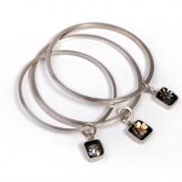 Silver bracelets by Angela Thoo