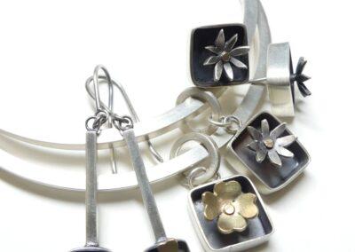 Angela Thoo - Silver flower pendant and earrings